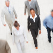 Royalty-Free Stock Photo: Blurred image of a team of business , walking