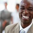 Royalty-Free Stock Photo: A laughing African American business man with coworkers standing