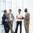 Business colleagues busy in a discussion at the hallway - Stock Photo