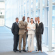Royalty-Free Stock Photo: Confident business colleagues standing at a hallway