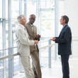 Royalty-Free Stock Photo: Successful business colleagues standing near a glass railing and