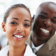 Two African American business smiling together - Stock Photo