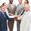 Royalty-Free Stock Photo: Happy team of business colleagues with their hands together in u