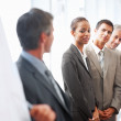 Royalty-Free Stock Photo: Team of business being lectured by a speaker at a confere