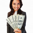A young business woman holding cash and smiling - Stock Photo