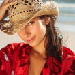 Cute female wearing a cane hat at the beach - Stock Photo