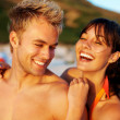 Royalty-Free Stock Photo: Cute couple enjoying themselves at the beach