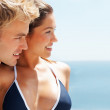 Cute couple having fun at the beach vacation - Stock Photo