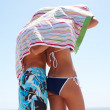 Rear view of young couple at the beach - Stock Photo