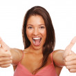 Royalty-Free Stock Photo: Thumbs up: Cute woman gesturing over white