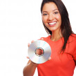 Young woman with CD smiling over white background - Stock Photo