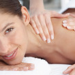 Young woman being massaged at the day spa - Stock Photo