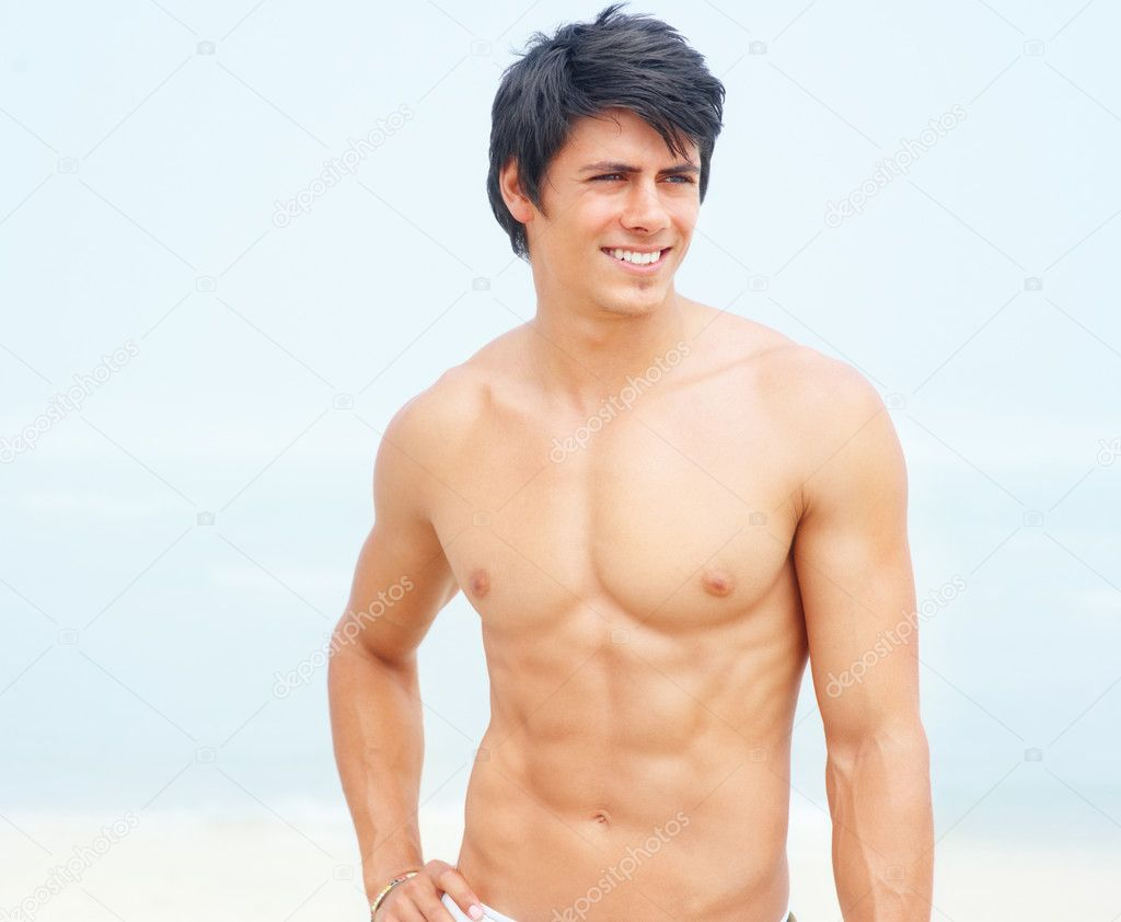 Portrait of a masculine young man standing without a shirt — Stock Photo #3323016