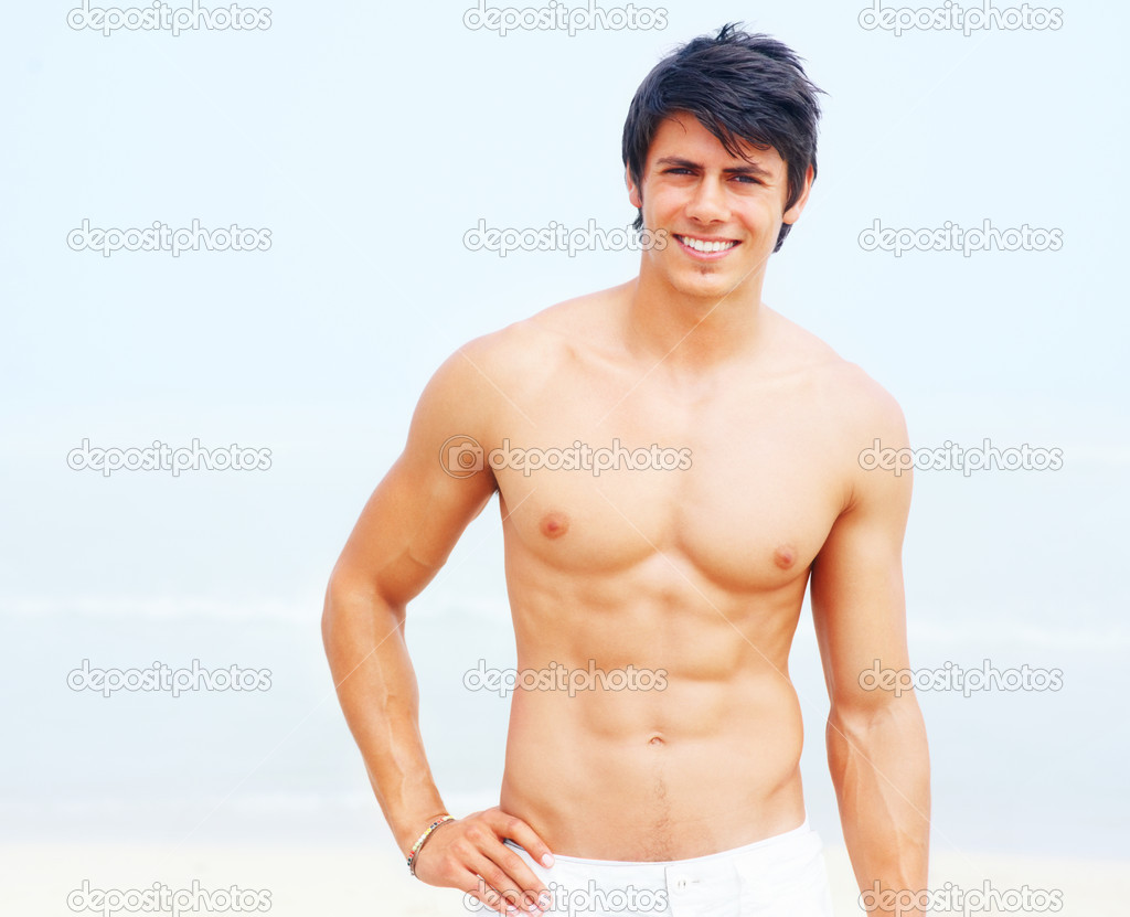 Portrait of a smiling masculine young man standing without a shirt — Stock Photo #3323019