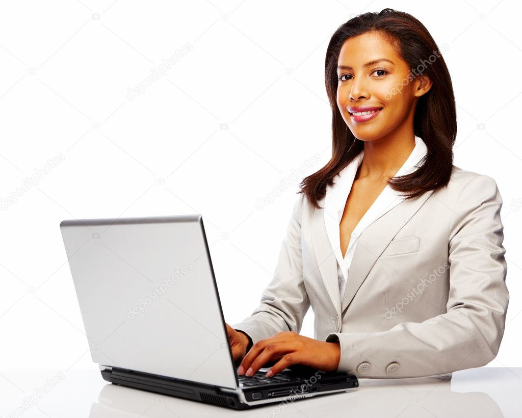 Young confident African American business woman working on a laptop, isolated on white background — Stock Photo #3323313