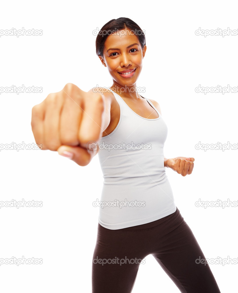 Young woman fitness exercising with hands closed in fists over white background  Stock Photo #3323439