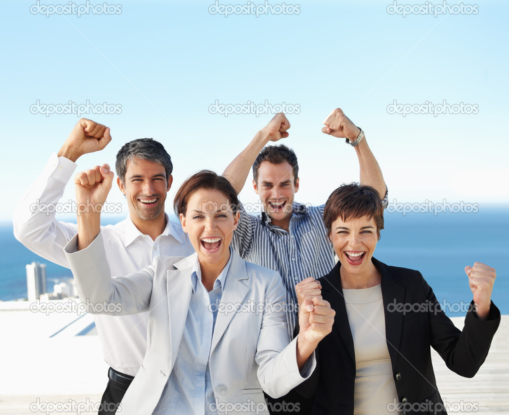 Group of an excited successful business team — Stock Photo #3325223