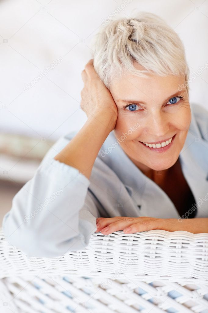A relaxed old lady smiling, isolated at home — Stock Photo #3325379