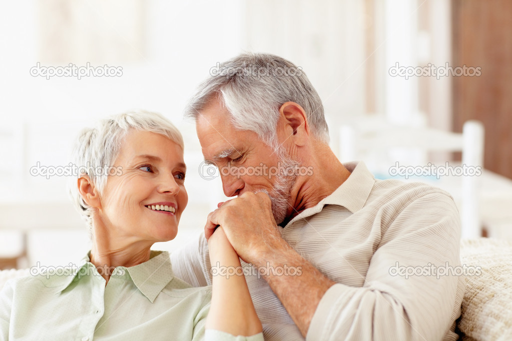 Portrait of a cute old couple caring for each other — Stock Photo #3325416