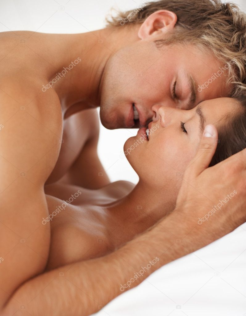Happy young couple enjoying sexual intercourse together  Stock Photo #3325875