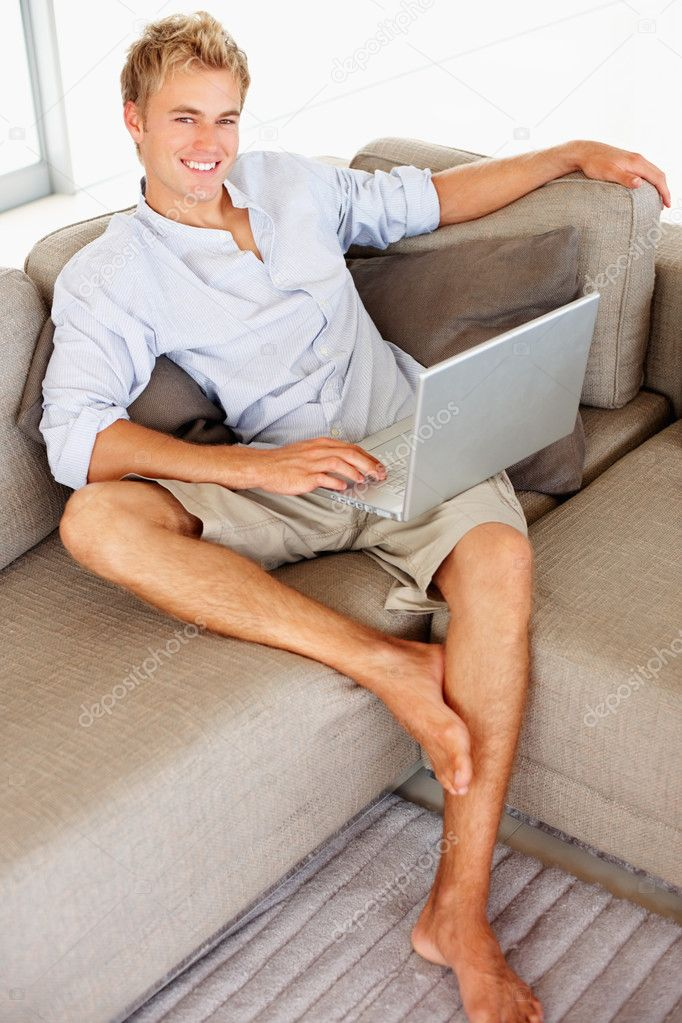 Portrait of a young business man working on a laptop — Stock Photo #3326124