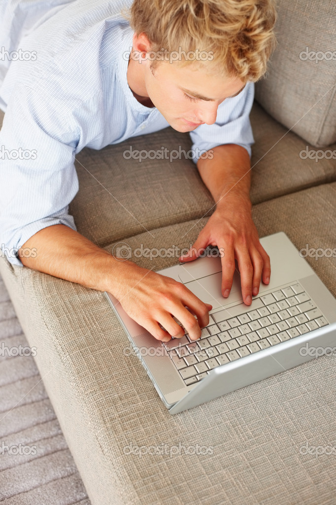 Portrait of a young business man working on a laptop — Stock Photo #3326139