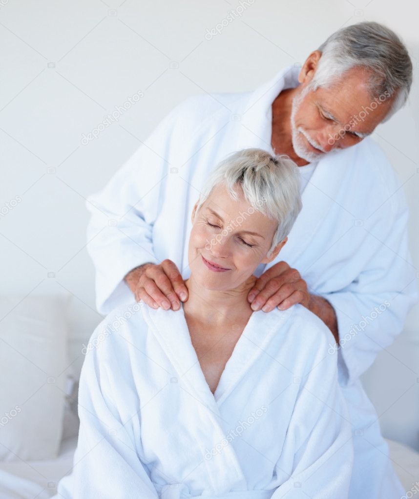 Mature woman getting a shoulder massage from husband