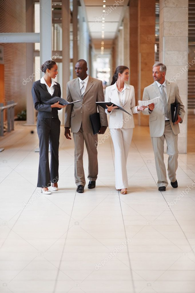 Happy business colleagues holding file at a hallway — Stock Photo #3326907