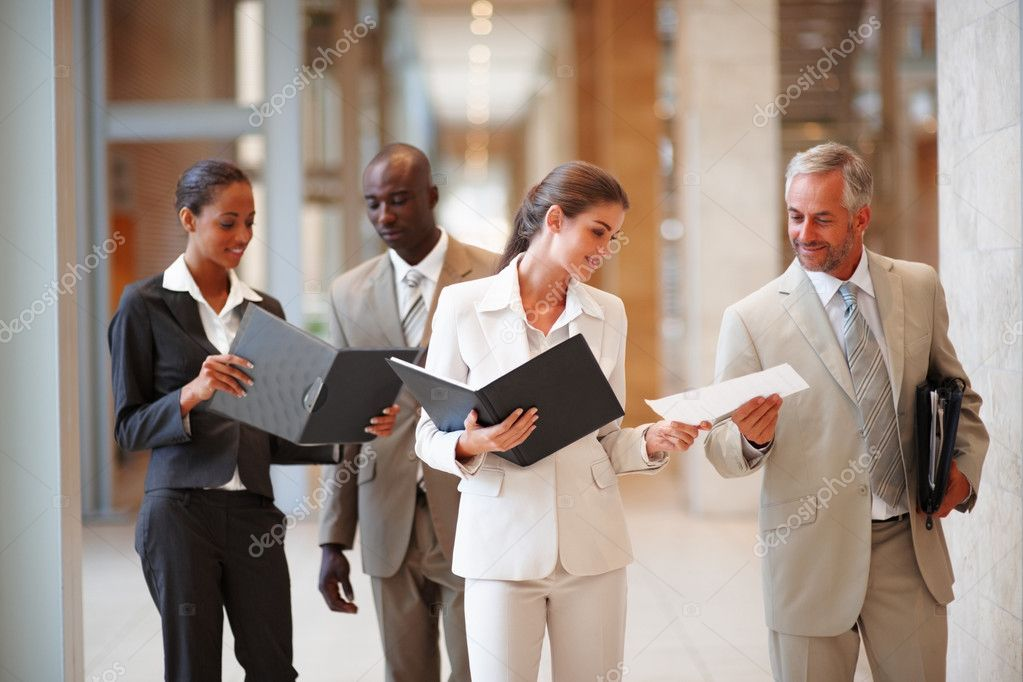 Happy group of business colleagues at a hallway — Stock Photo #3326913