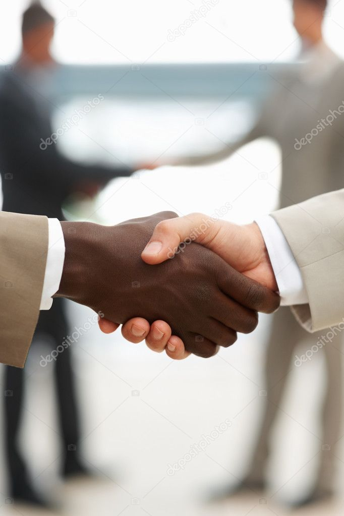 Closeup of a multiracial handshake between two business men — Stock Photo #3326960