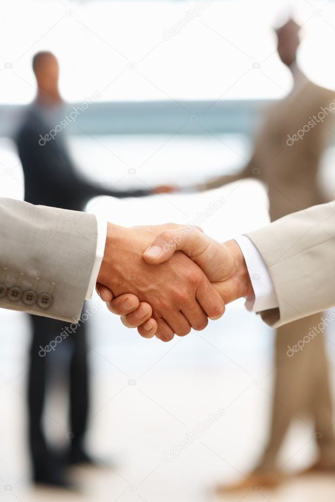 Closeup of business shaking hands, act of agreement — Stock Photo #3326962