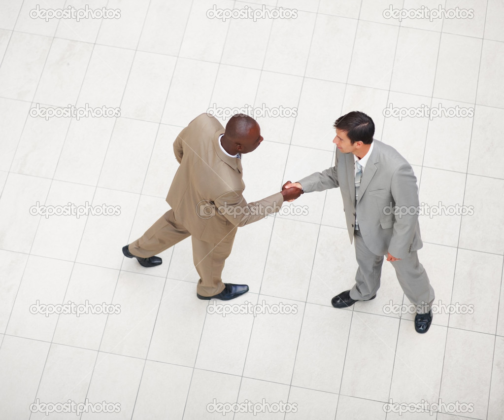 Above view of a two business men greeting eachother  Stock Photo #3327188
