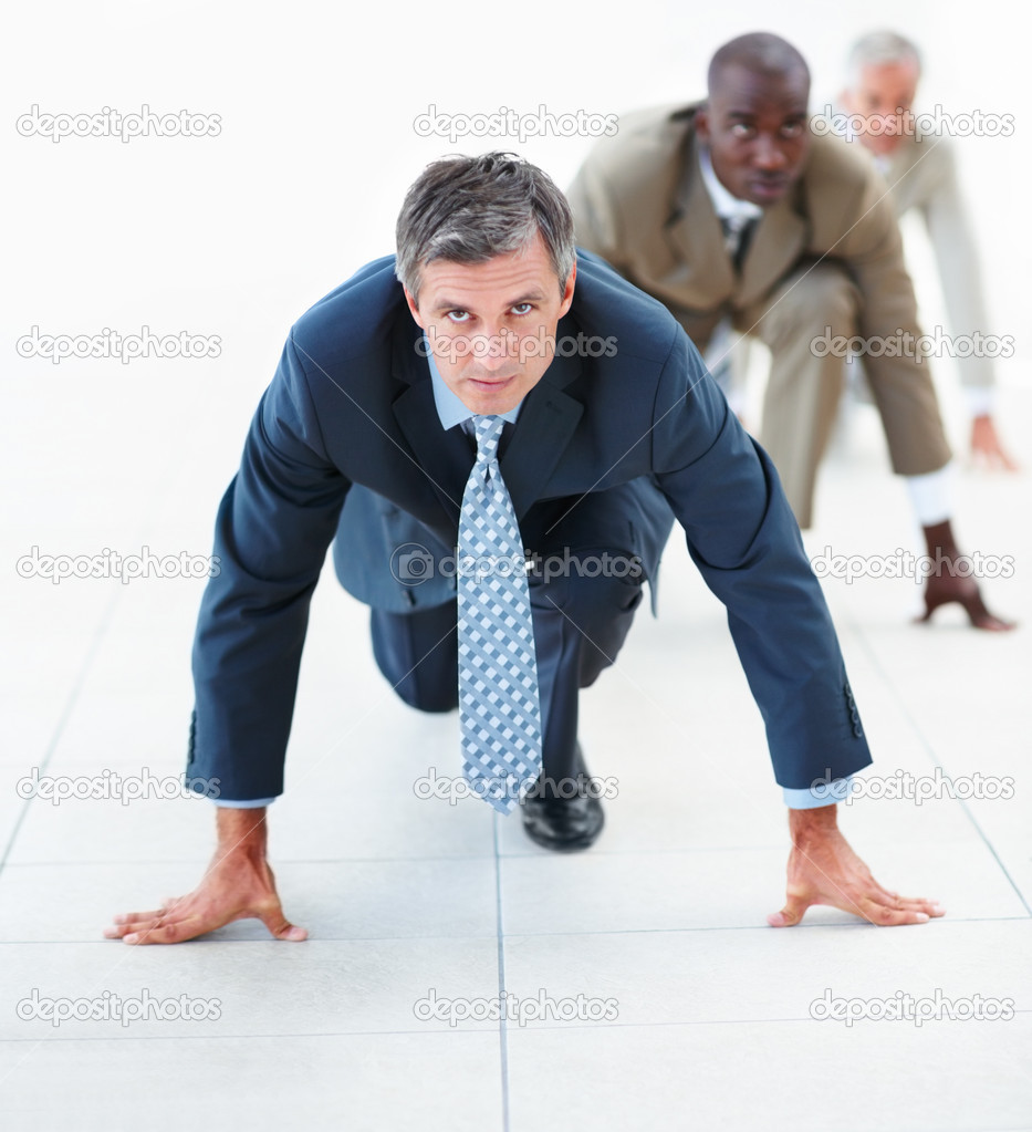 Elderly business man in position for a race — Stock Photo #3327560