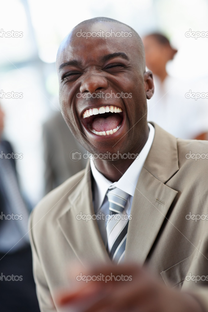 A laughing cheerful African American business man — Stock Photo #3327610