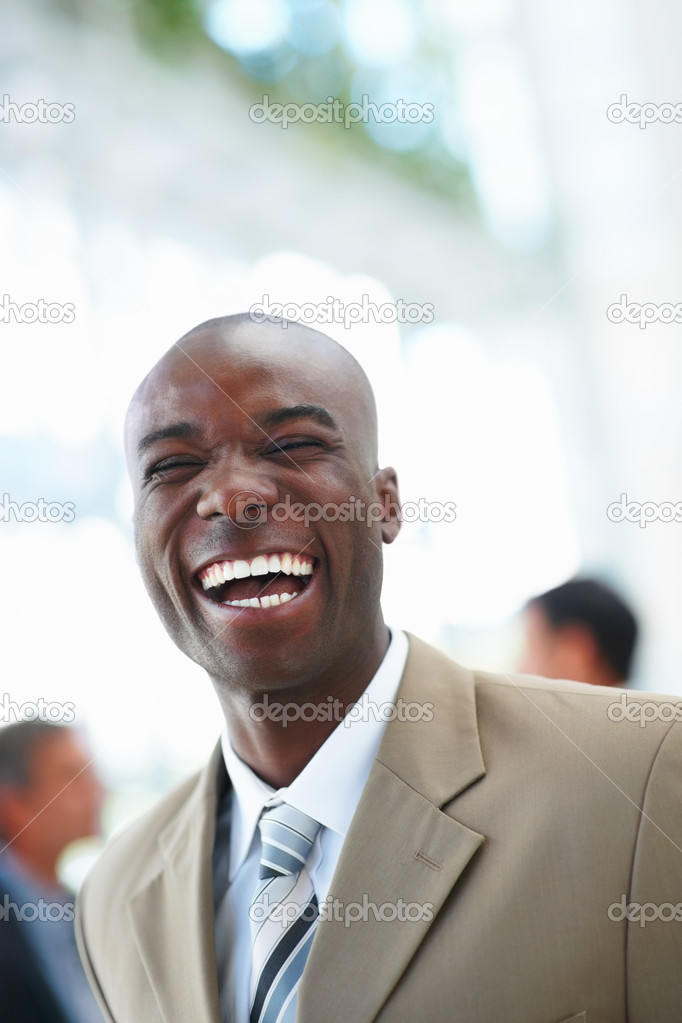 A creative business man laughing with at the background — Stock Photo #3327627