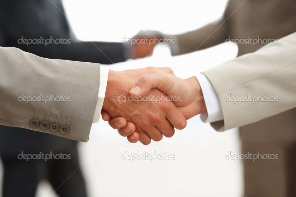 Closeup of business shaking hands at the workplace — Stock Photo #3327887