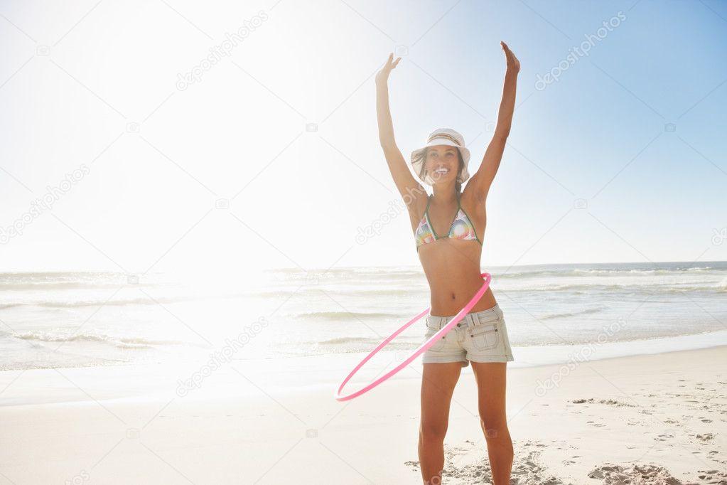 depositphotos 3328467 A teenage girl using Hula Hoop at the beach naruto anime adult porn hentai manga