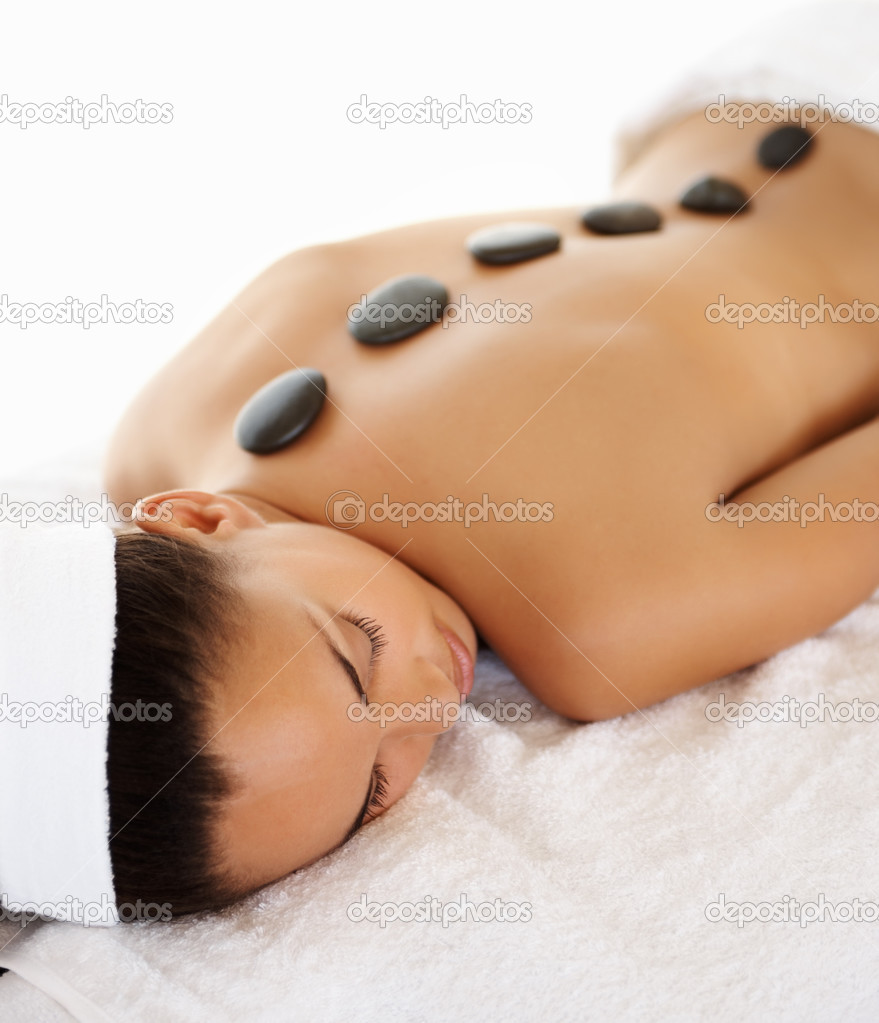Cute woman getting spa treatment with stone massage — Stock Photo #3328706