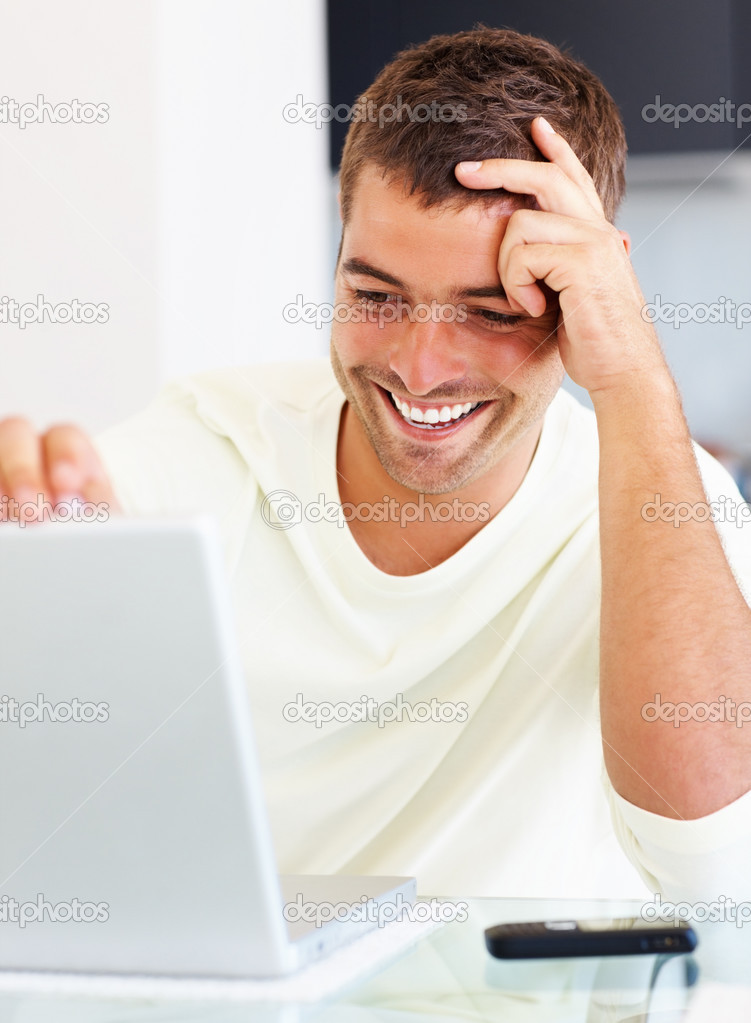 Closeup of a happy young man looking at laptop  Stock Photo #3328728