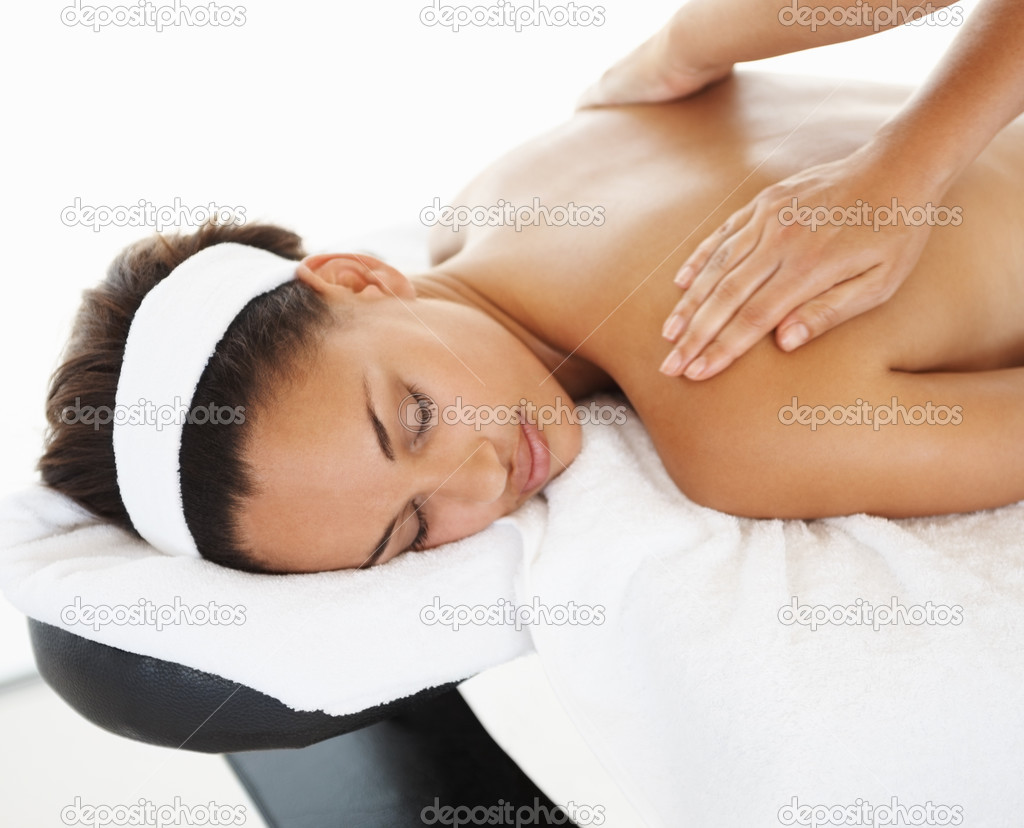 Cute female getting a body massage over white background — Stock Photo #3328811