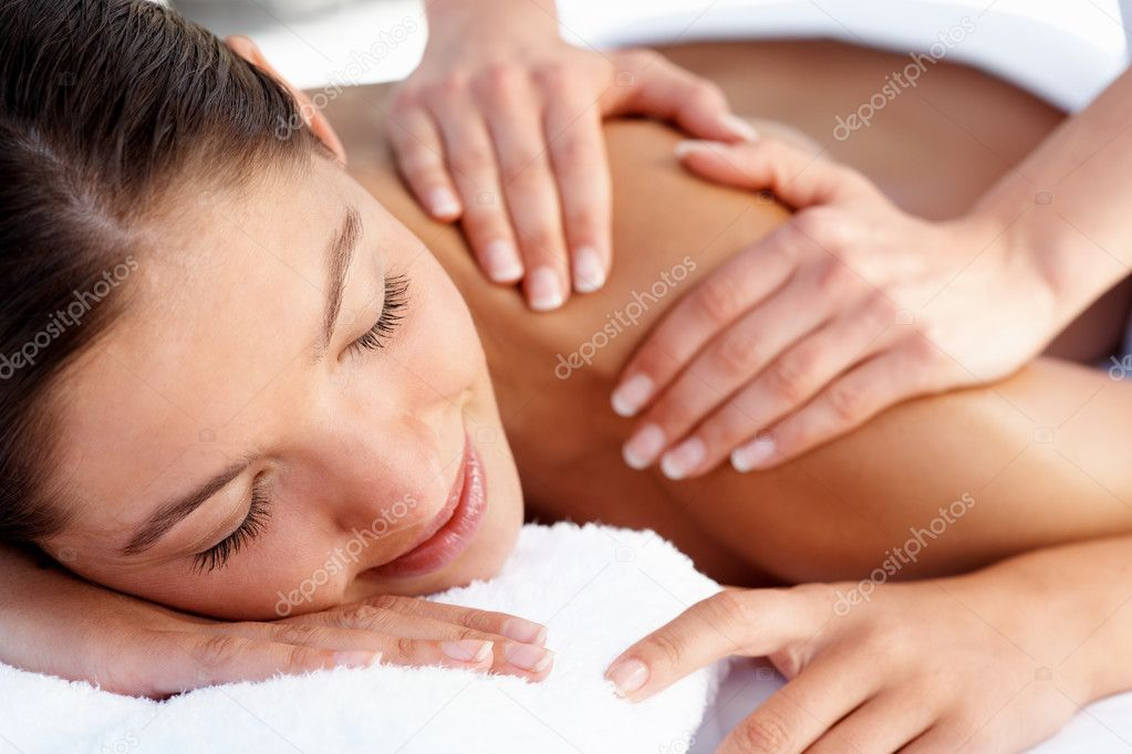 Young female getting a body massage at the day spa  Stock Photo #3329904