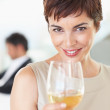Royalty-Free Stock Photo: Beautiful business woman holding a glass of drink