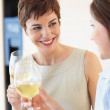 Royalty-Free Stock Photo: Two female celebrating with a glass of white wine
