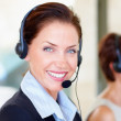 Royalty-Free Stock Photo: Closeup of a happy young call centre employee at work