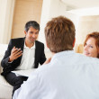 Young couple in meeting with investment consultant - Foto Stock