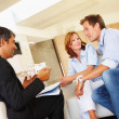 Happy couple in meeting with a estate agent - Stockfoto