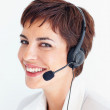 Royalty-Free Stock Photo: Beautiful receptionist with a headset smiling over white backgro