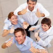 Royalty-Free Stock Photo: Top view of a business team showing a success sign