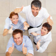 Royalty-Free Stock Photo: Happy group of business colleagues showing a thumbs up