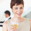 Royalty-Free Stock Photo: Beautiful business woman holding a glass